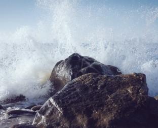 rocks with ocean splashing