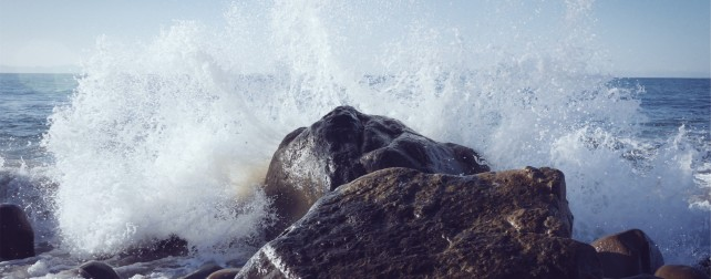 rocks with ocean splashing